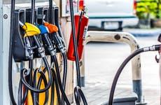three gas pumps at fuel station