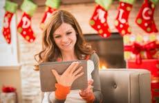 Woman using tablet at Christmas