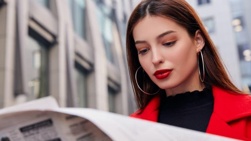 A woman reads a newspaper