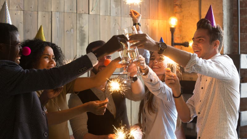 A group of friends toast to the new year