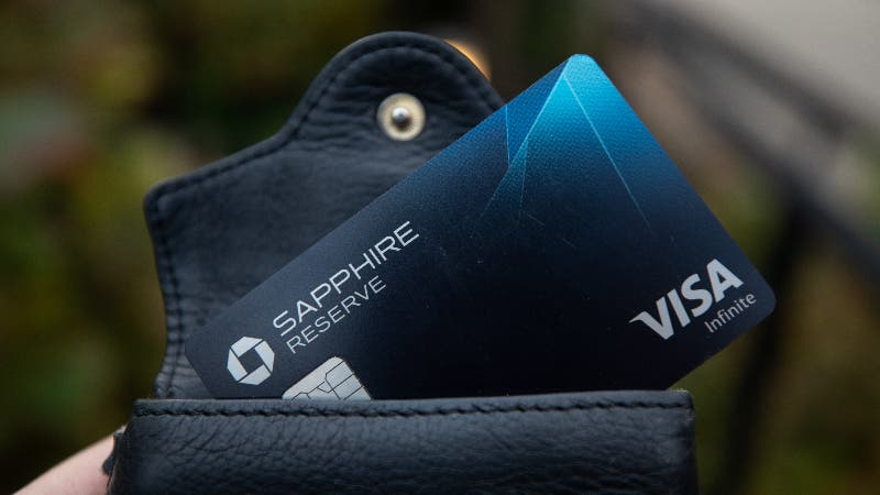 Chase Sapphire Reserve card sticking out from black leather wallet