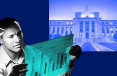 Man looking at bar graph amid Federal Reserve Eccles Building