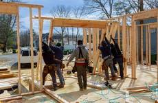 Men building home