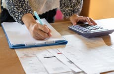 Woman calculating debt payments