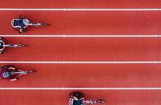 A photo of paracylcists racing along a track