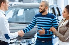 A couple buys a car.