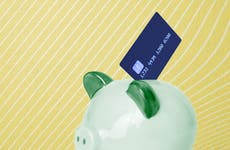 An illustration of a piggy bank and credit card.