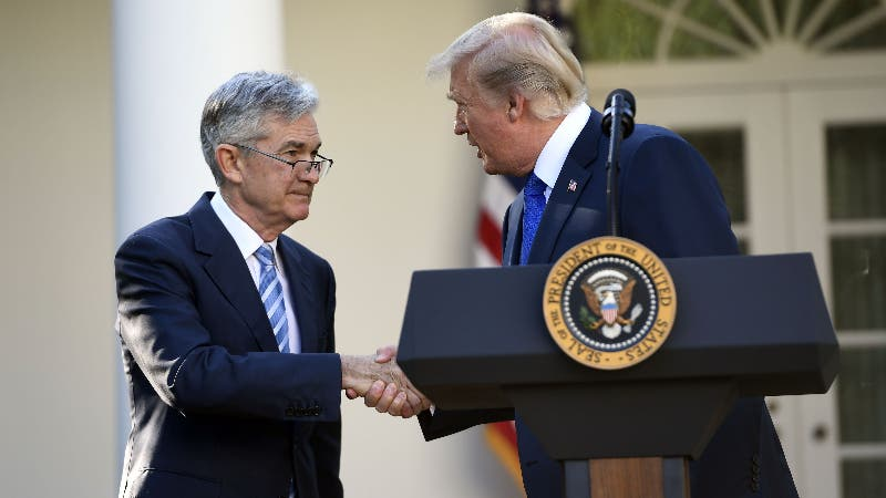 President Donald Trump shakes the hand of Fed Chairman Jerome Powell