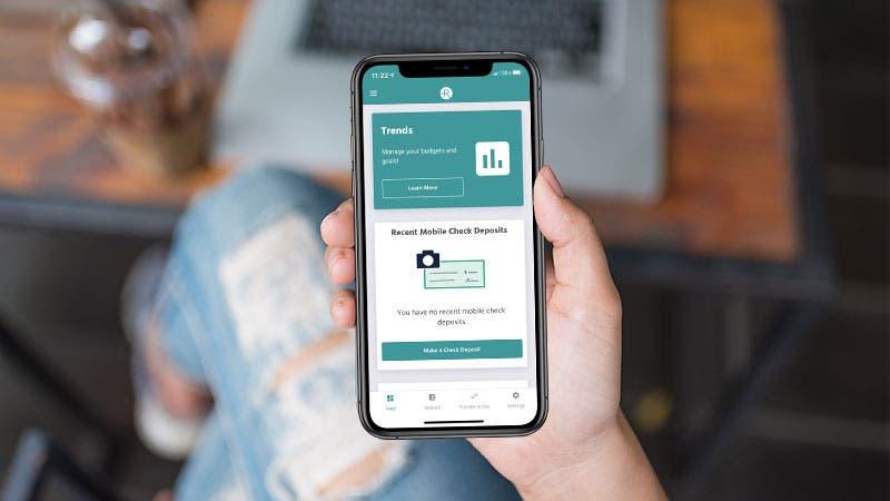 A woman uses her Radius Bank mobile app.