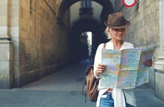 Young female traveler looking at a map