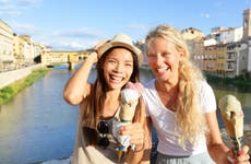 Young female friends enjoying ice cream in Florence, Italy