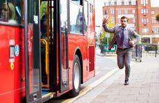 A man runs to catch a bus.