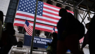 Here's how top economists predict the coronavirus will impact the U.S. economy