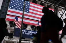 People walk outside the New York Stock Exchange
