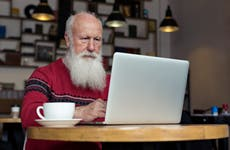An older man researches online.
