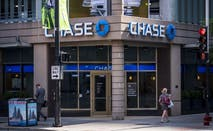 Customers walk past a Chase Bank branch.