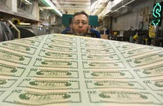 Man prints $20 bills at the Bureau of Engraving and Printing