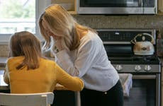 Coronavirus lockdown means kids are homeschooling, here mom is helping daughter with homework