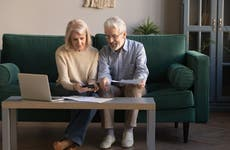 An older couple researches their finances together.