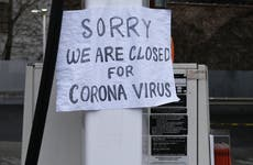 """A sign in Queens hangs sign that says """"closed for corona virus."""""""