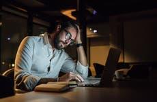 Man on his laptop at night