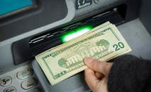 A customer withdraws cash from an ATM.