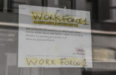 A sign stating that job placement program is closed during coronavirus pandemic.
