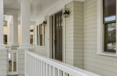 Shot of a pristine porch with white railing.