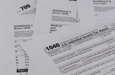 A pile of IRS 1040 tax forms