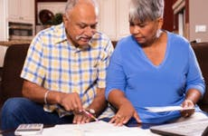 An older couple looks over their finances