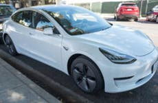 Shot of a white Tesla parked along the street