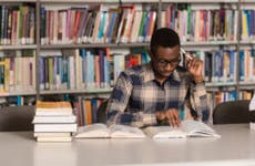 College student studying in library.
