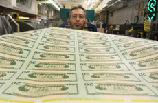 Freshly printed $20 bills are inspected at the Bureau of Engraving and Printing