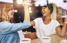 Happy women high five in cafe