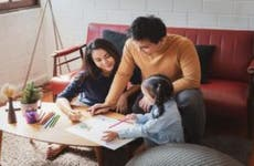 A young family spends time together at home.