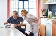 Mature couple at home using laptop to plan home finances