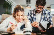 Young couple works on taxes together