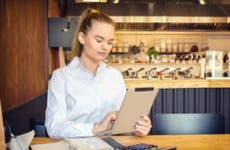 Woman works on finances at work