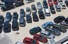 Aerial view of automobiles parked in symmetrical pattern