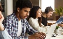High school students study on laptops
