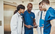 Group of doctors and nurses discuss paperwork