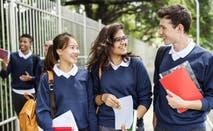 High school students walk around campus