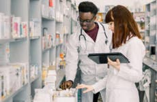 Two pharmacists look through medications
