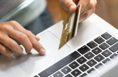 Person on laptop with credit card