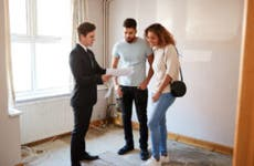 Homebuyers with their real estate agent tour a listing.