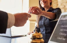 Person handing over credit card at hotel