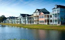 Townhomes seen across a pond.