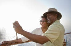 Older black couple taking a selfie together on a cruise ship.