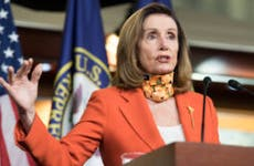 Speaker of the House Nancy Pelosi speaks from a lectern