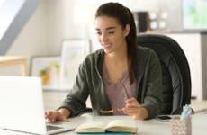 High school student works on laptop